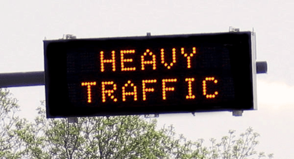 """A digital sign that reads, """"heavy traffic"""""""