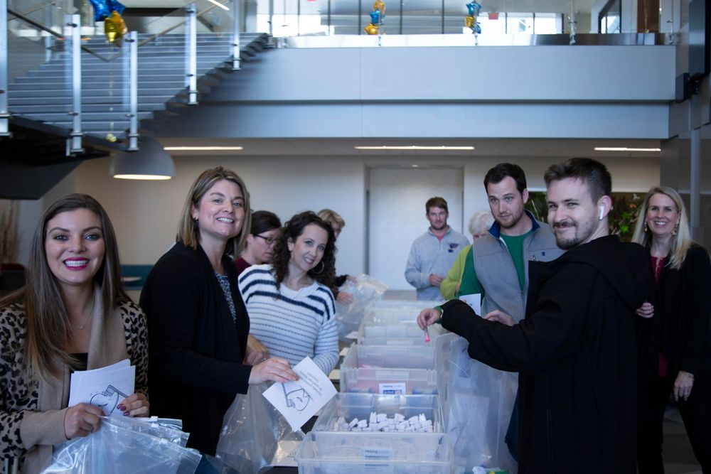 WWT employees assembling care bags