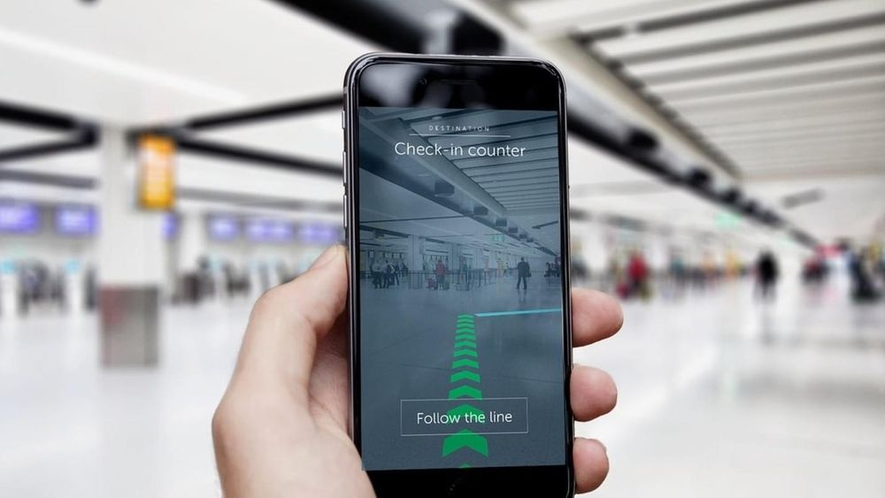 Example of markerless AR with smartphone held up displaying an in-store navigation path.