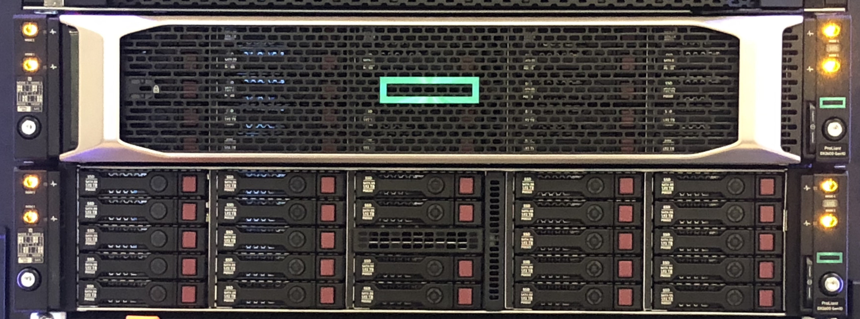 HPE DX Powered on in the WWT ATC. One with bezel, other without.