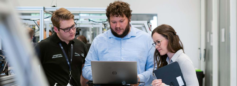 Employees looking at laptop