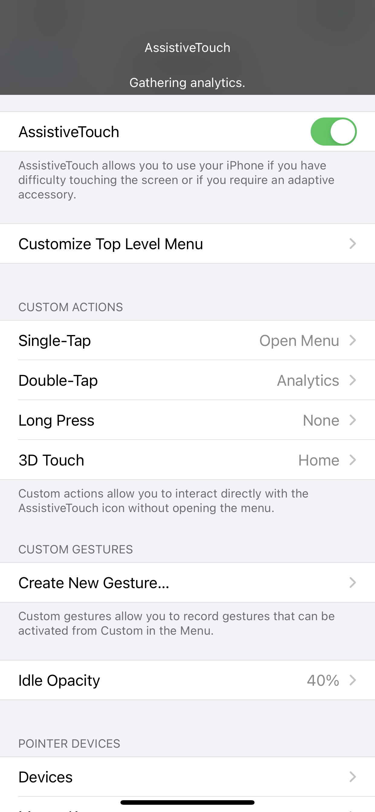 AssisstiveTouch settings screen with Gathering Analytics notification