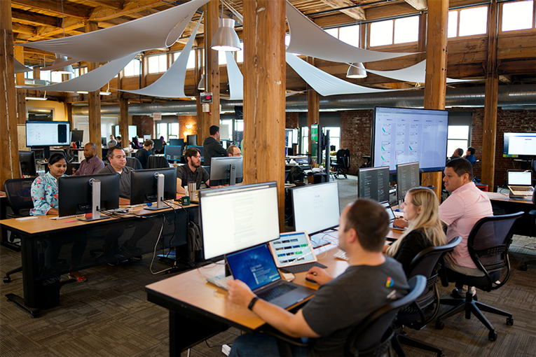 View of WWT Application Services office space and software developers.